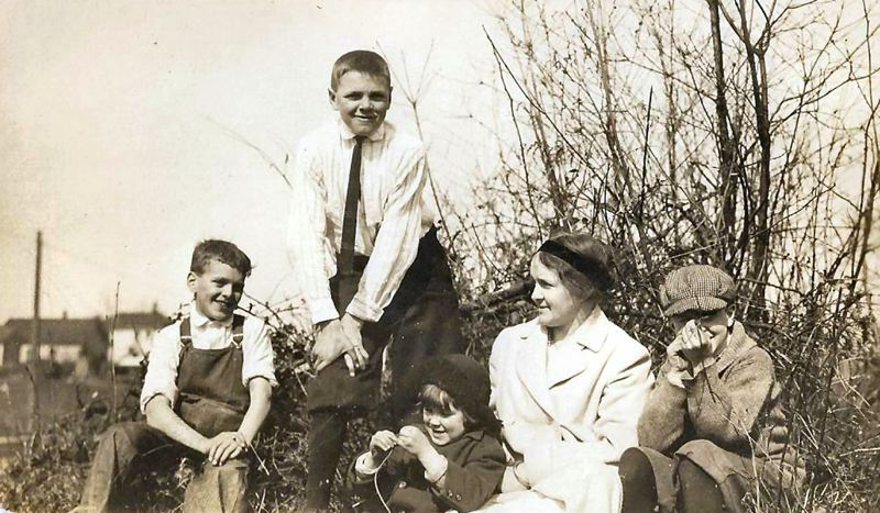 by: COURTESY OF THE STRONG FAMILY - The Brooklyn Boys with their mother. From left: Hillman Strong, Edward Strong, Winston Strong sitting by his mom Ethel Strong, and Ray Strong in his cap. Family photo from the early 1900s.