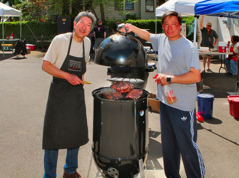 by: DAVID F. ASHTON - Peter Chow shows off what he hopes will be prize-winning barbecue to instructor Gregg Fujino.