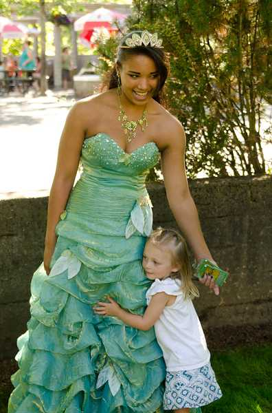 by: SUBMITTED PHOTO: MICHAEL DURHAM - The Dragon Theaters frog princess gets a hug from a young fan during Sunset at the Zoo last summer.