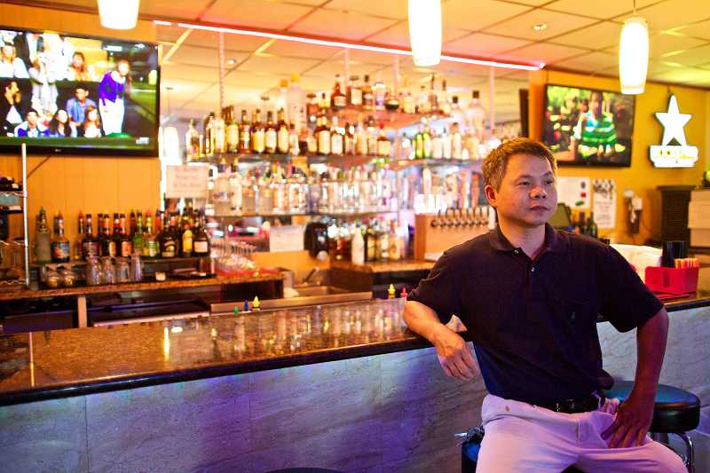 by: TIMES PHOTO: JAIME VALDEZ - Lus Sports Bar in Tigard plans to start hosting Texas Hold Em tournaments this month after the city approved a new ordinance allowing social gaming in city limits.