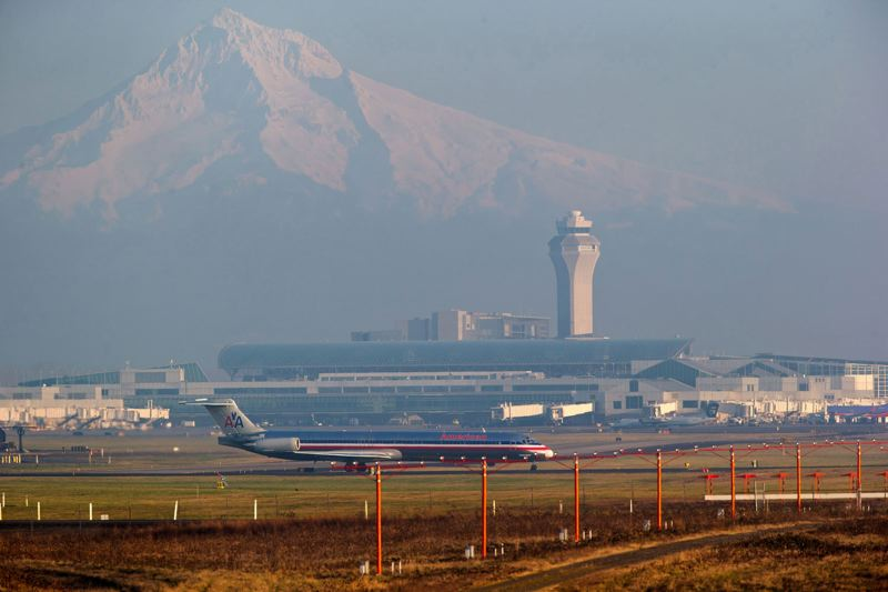 by: TRIBUNE FILE PHOTO: CHRISTOPHER ONSTOTT - Portland International Airport is a busy place these days as full flights and a lot of passengers push it toward a travel record.