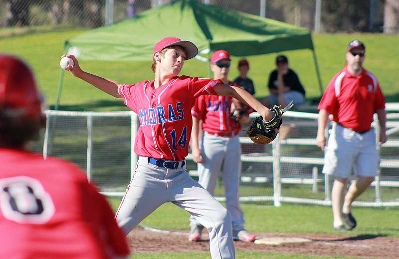 by: BILLY GATES/THE PIONEER - Jefferson County pitcher Brendon Chess throws from the mound during the Oregon District 5 