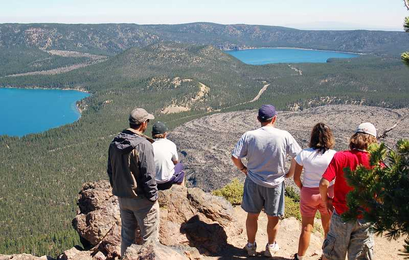by: SCOTT STAATS - Visitors look over Paulina Lake (left) and East Lake with a big obsidian flow below.
