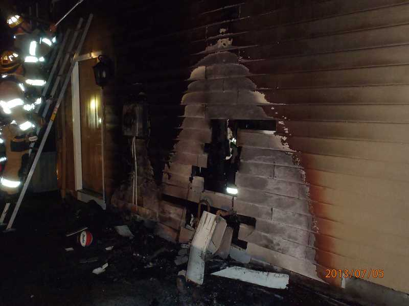 by: SUBMITTED PHOTO: TVF&R - A house fire in West Linn started after used fireworks were placed in a bag near the exterior of a home.