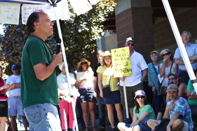 by: PAMPLIN MEDIA GROUP PHOTO: JAIME VALDEZ - Kent Addleman of Tigard who is a third-generation beekeeper, addresses his concerns in front of about 100 people during a bee memorial at the parking lot at Wilsonville Target.