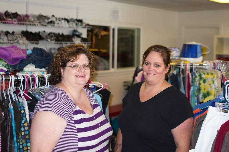 by: HILLSBORO TRIBUNE PHOTO: CHASE ALLGOOD - Missy Wolfe and Tiffany Grenfell are working members of the Foster Closet board.