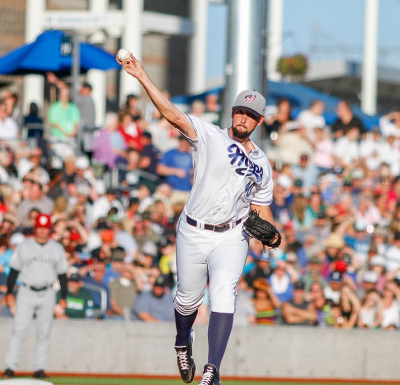 by: PAMPLIN MEDIA GROUP: CHASE ALLGOOD - Jonathan Pulley, Hillsboro Hops starting pitcher, gets on out with a play in the field at Hillsboro Ballpark.