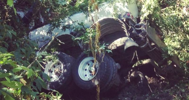 by: COURTESY OF KOIN 6 NEWS/NADIA MULYAR - KOIN 6 News follower Nadia Mulyar shot this image of an overturned truck near Johnson Creek Monday afternoon, July 8. The driver died in the rollover collision.