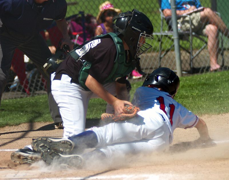 by: DAN BROOD - TAGGED OUT -- Tigard Little League catcher Nathan Ibarra (left) tags out Cedar Mill's Daniel Hext during play Sunday at the District 4 ages 10-11 all-star tourament being played at Cook Park. Tigard split its first two games at the tournament.