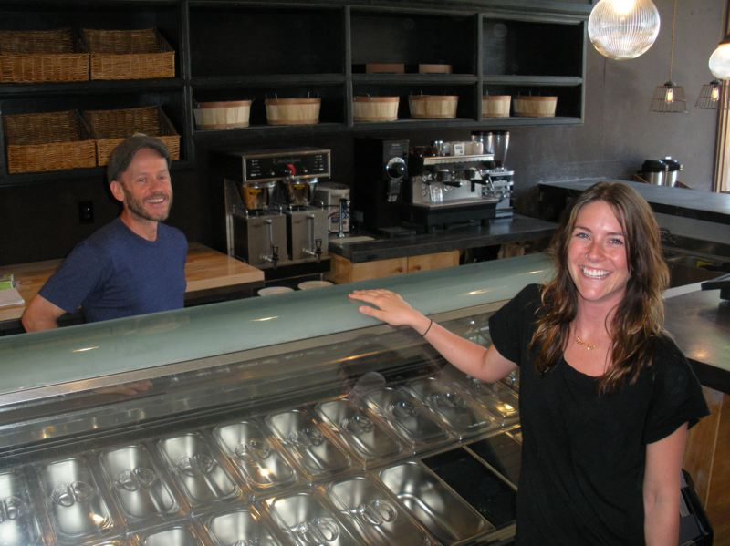 by: POST PHOTO: JIM HART - Chef Damon Schwab, left, and Cafe Manager Samara Davis are pictured near the gelato cabinet inside the AntFarm Cafe, which is planning a soft opening Thursday at 4 p.m. The new cafe will be open each day during the Festival weekend.