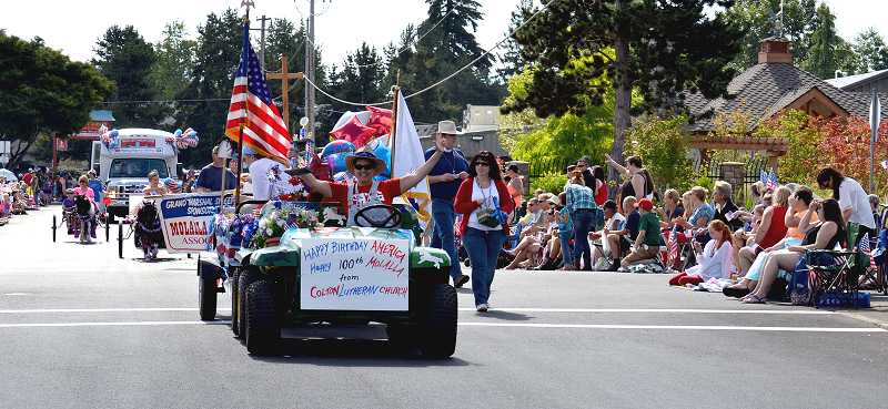 by: CINDY FAMA - The Colton Lutheran Church float won the Director's Sweepstakes trophy in the Molalla July 4 parade.