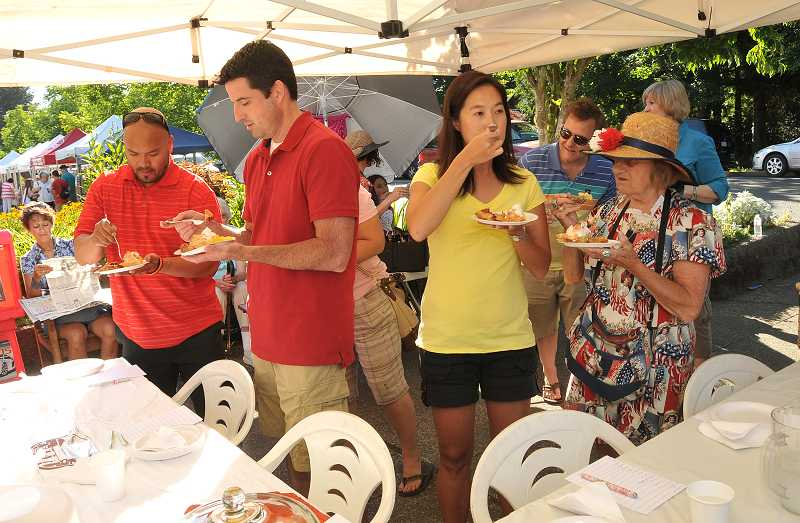 by: TIDINGS PHOTO: VERN UYETAKE - From left, judges Adam Kekahuna, Drew Carney, Jenni Tan and Alice Richmond taste selections from the 13 pies submitted to the bake-off.