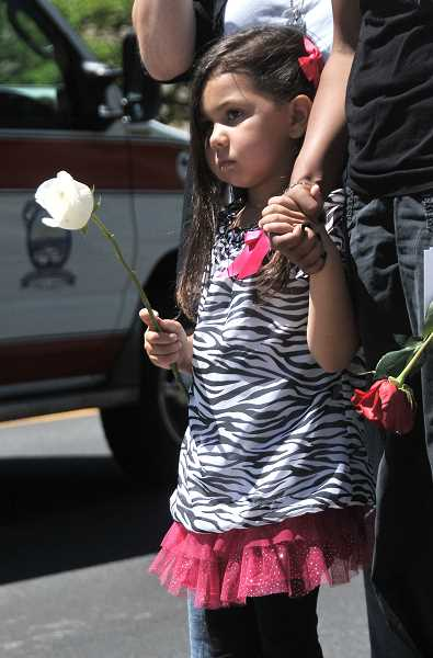 by: VERN UYETAKE - Kylie Steinmetz, of Vancouver, watched the ceremony at the Lake Oswego Main Fire Station on Wednesday.