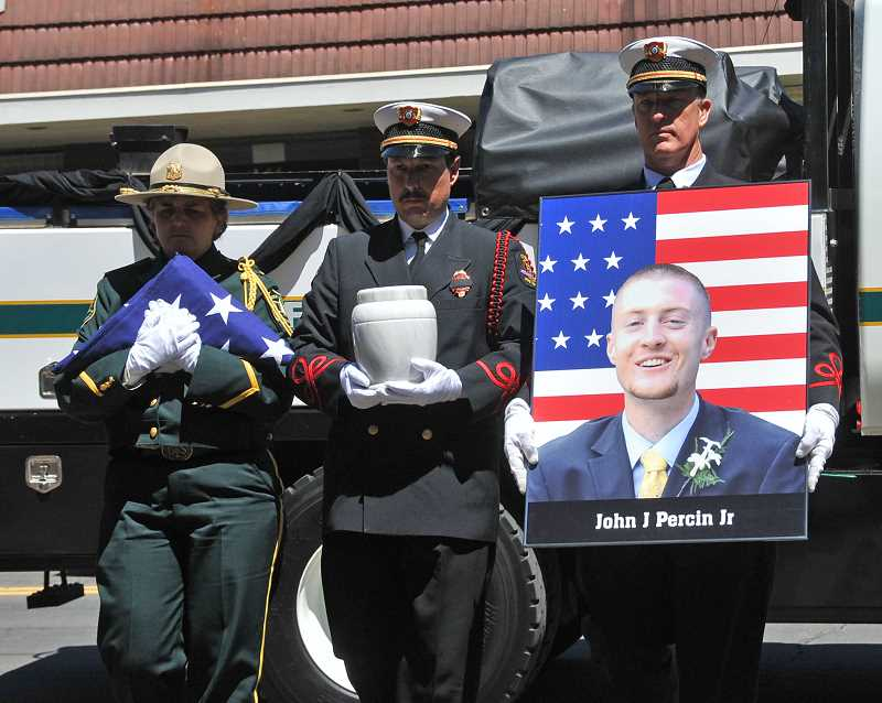 by: VERN UYETAKE - A photo of John J. Percin Jr. and a flag accompanied the urn carrying his ashes during a processional involving dozens of emergency responders.