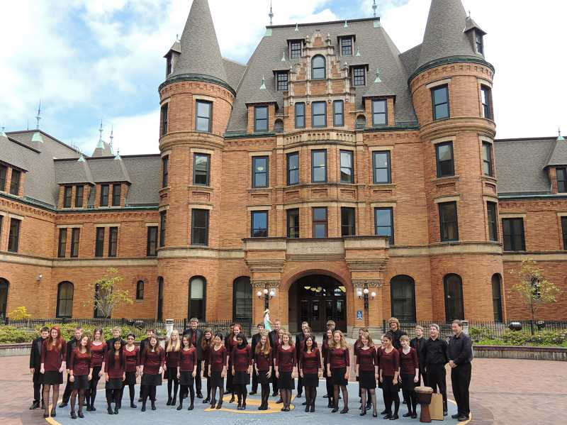 by: SUBMITTED PHOTO - Members of Athey Creeks Select Choir pose outside Stadium High School in Tacoma.