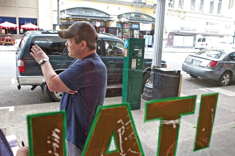by: TRIBUNE PHOTO: JAIME VALDEZ - Matt Weiler, co-owner of Geraldis on 4th, explains his daily habit of parking his own SUV in front of his  business all day, and apartment owners with disability placards leaving their cars at metered spaces for days on end.
