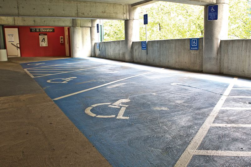 by: TRIBUNE PHOTO: JAIME VALDEZ - Downtown parking garages have plenty of spaces set aside for disabled drivers, but they're rarely used as drivers opt for free parking at curbside meters.