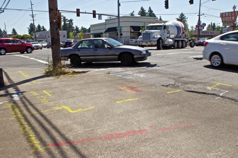 by: TRIBUNE PHOTO: JAIME VALDEZ - Sidewalk markings at Southeast Powell Boulevard and 122nd Avenue denote future safety improvements by the Oregon Department of Transportation. The intersection has the most accidents of any in Oregon.