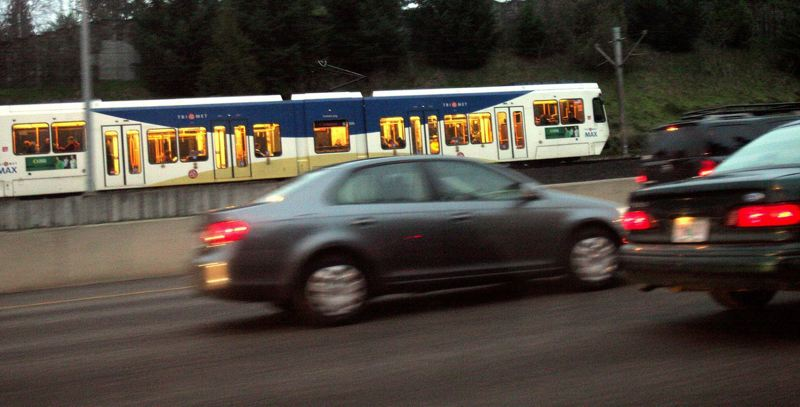 by: FILE PHOTO - Area officials are expected to rule this month whether both MAX light rail and bus rapid transit should be considered out to Tigard and Tualatin.