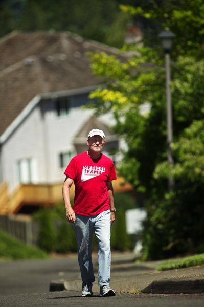 by: TIMES PHOTO: JAIME VALDEZ - Bas Vanderzalm, 65, recently walked 220 miles from Redmond, Wash. to Tigard. Vanderzalm was president of Medical Teams International.