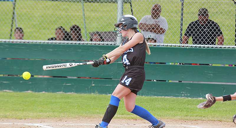 by: BILLY GATES/THE PIONEER - Leah Buck rips a base hit for the Jefferson County junior softball team during the district tournament in Bend. Buck, and the rest of her teammates, beat Columbia twice to claim the district title July 4. They will now advance to the state tournament, which begins Saturday in Klamath Falls.