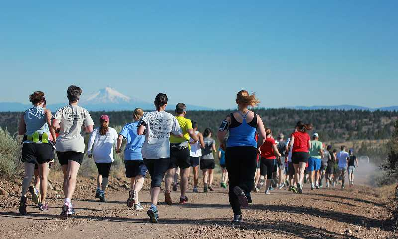 by: BILLY GATES/THE PIONEER - Runners were treated to stunning views of the Cascade Mountains during the beginning of the Todd Beamer Memorial 10K run Thursday.