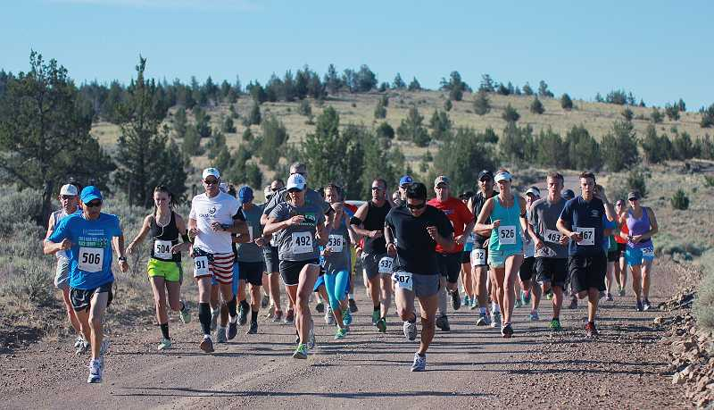 by: BILLY GATES/THE PIONEER - Runners start the 10K race on Grizzly Road during the Todd Beamer Memorial Run, held Thursday. The race finished at Sahalee Park.