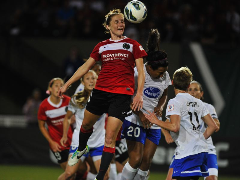 by: COURTESY OF JOHN LARIVIERE - Rachel Buehler of the Portland Thorns wins a header over Boston Breakers midfielder Mariah Nogueira during last week's game at Jeld-Wen Field.