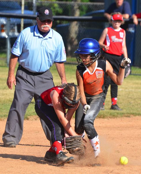 by: JOHN BREWINGTON - Collision at second. Scappoose's Jada Dickerson runs into Willamette second baseman during the opening game of the Little League softball 9-10s district tournament. Scappoose lost the game in extra innings.