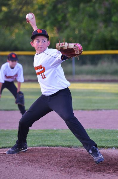 by: JOHN BREWINGTON - Scappoose's Ben Anicker relieved during the opening game of the Little League 10-11s tournament. He shut down Hollywood/Rose City and Scappoose came from a 6-0 deficit to a 13-6 win.