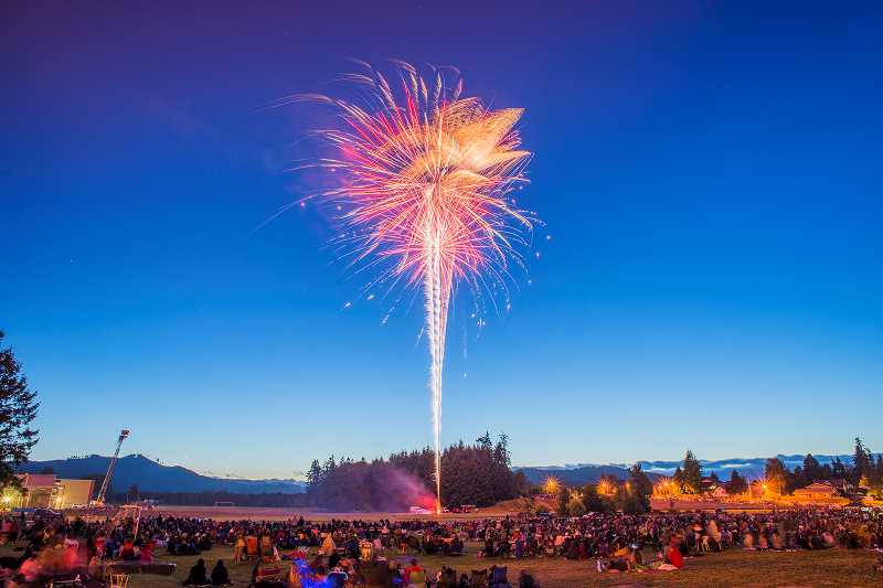 by: NEWS-TIMES PHOTO: CHASE ALLGOOD - A colorful burst lights up the night sky over Tom McCall Upper Elementary School in Forest Grove July 4 as the annual fireworks display returned to town for a second year.