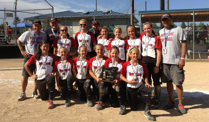 by: SUBMITTED - The Oregon City Nightmare did themselves proud at the recent Oregon Amateur Softball Association 12-B State Tournament, bagging the second-place team trophy. Pictured with their trophy are Nightmare players and coaches: (front row, from left) Brooklynn Yee, Brooke Bullock, Katie Schroeder, Emily Dugan, Maddie Krekel and Maddie Miller; and (second row) head coach Jeff Schroeder, coach Bret McCullough, Brooklyn Roberts, Samantha Brewster, coach Carrie Miller, Kora McCullough, Kiley Maynard, Emily Gates, Hannah Jagow and coach Kevin Miller.