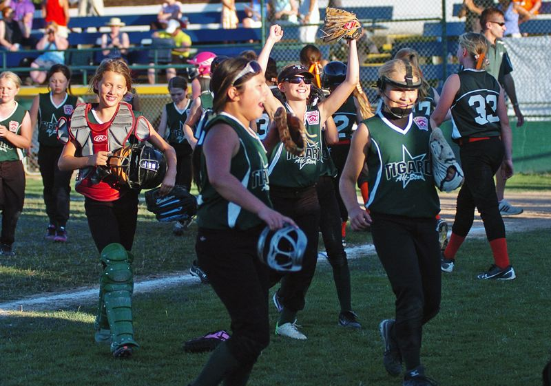 by: DAN BROOD - WE DID IT -- Members of the Tigard Little League ages 9-10 softball all-star team celebrate following their 14-9 victory over Southwest Portland in Tuesday's District 4 tournament championship game.