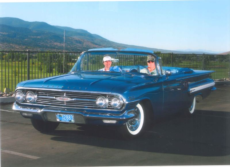 by: PHOTO COURTESY: MCDONALD FAMILY - Sharon McDonald hands the steering wheel of her 1960 Chevy Impala over to her husband, Ronald, during their recent vacation to Nevada.