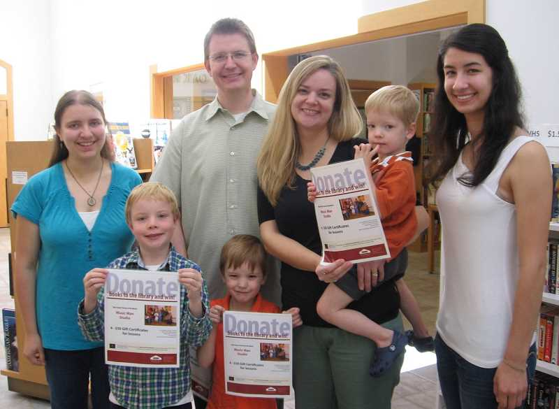 by: SUBMITTED - Shown, left to right, is winner Natalie Richards, Elijah, Nathan, Mason, Lori and Hudson Givens and Lindsey deCampos, who accepted a gift certificate on behalf of her mother, Cathy. Not pictured are Mike Thomson and Kathy Hight.