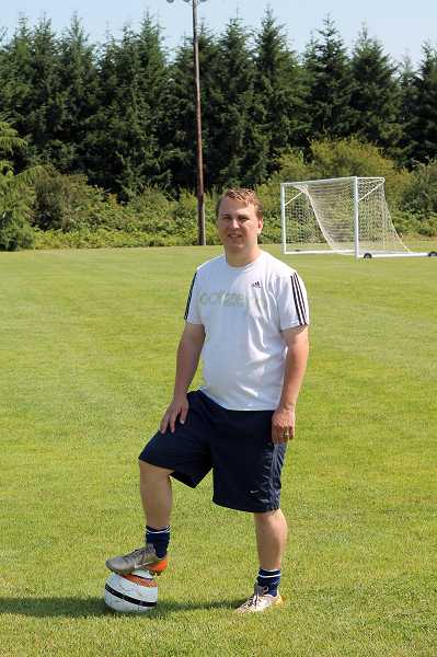 by: CORY MIMMS - Ryan Gate stepped in as coach of Molalla High School's boys soccer team in June.