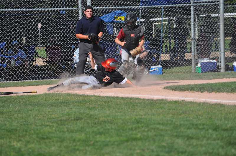 by: COURTESY OF TROY DONALDSON - Carson Donaldson slides into home, during the state playoffs.