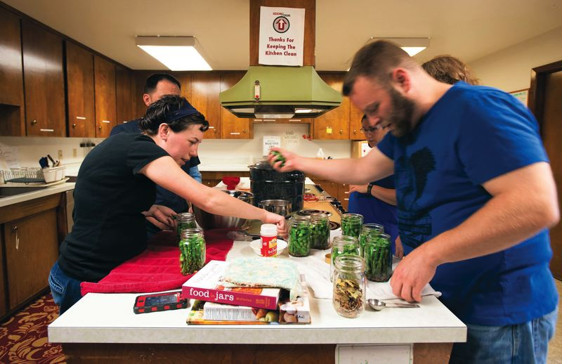 by: PAMPLIN MEDIA GROUP: NICK FOCHTMAN - Portlanders are learning and sharing food preservation skills at this St. Johns kitchen.