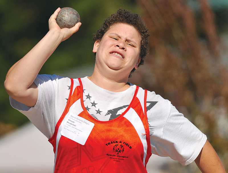 by: GARY ALLEN - Amanda Mendenhall of the Douglas County team competes in the shotput Saturday morning at Loran Douglas Field.