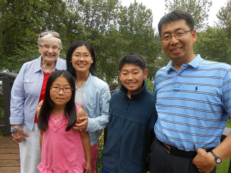 by: CLIFF NEWELL - Mary Spence, left, has been a great friend to the Noh family during their stay in Lake Oswego. She is saying farewell to mother, Sunghee; daughter, Hyowon; son, Wonjin; and father, Sangman.