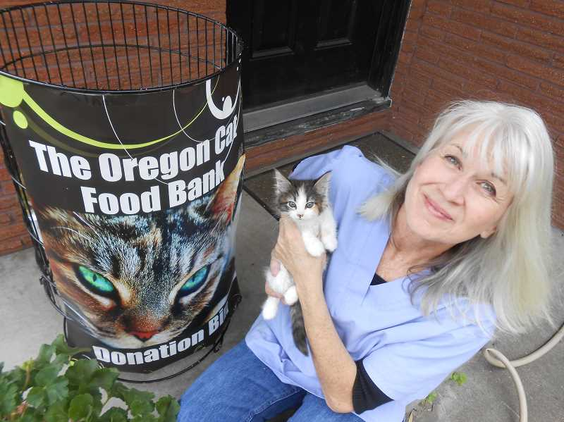 by: CLIFF NEWELL - Dana Lionel and Kitty the kitten are getting out the word that a new dog and cat food bank is coming to Lake Oswego.