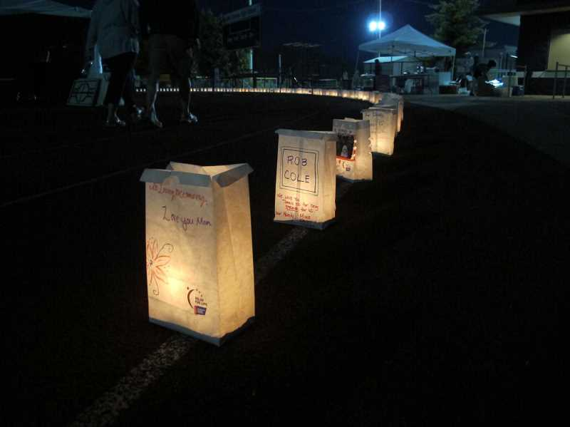 by: ERIC SAMUELSON - The light from the luminaries created to honor those with cancer added a hopeful glow to the night.