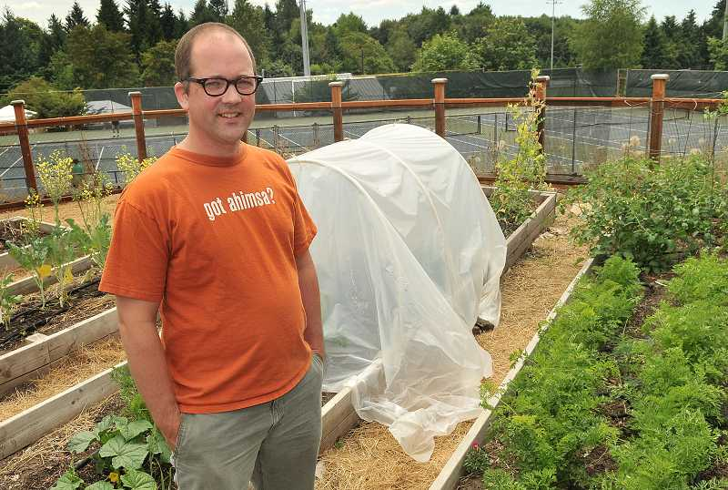 by: REVIEW PHOTO: VERN UYETAKE - LOHS social studies teacher Andrew Duden founded a school garden.