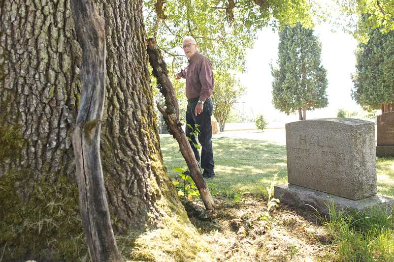 by: TIMES PHOTO: JAIME VALDEZ - Carl Bartruff walks by the headstone of Mary and Joshua Hall at the Union Schoolhouse Cemetery as he points out the graves of area settlers.