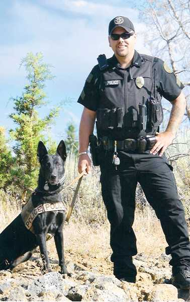 by: SUBMITTED PHOTO - Kelly, the K9 officer, and partner Sgt. Jason Schjoll, won Top Dog honors for the Warm Springs Police Department at the Bend dog trials.