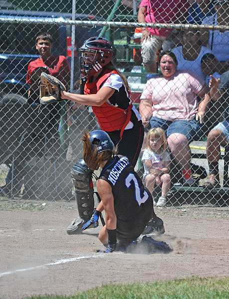 by: PHOTO BY ANNA WILLARD FOR THE PIONEER - Kianna Moschetti slides safely into home on a Kira Thomas triple in the top of the sixth inning Saturday as Tillamook catcher Lexie Zuercher waits for the throw home.