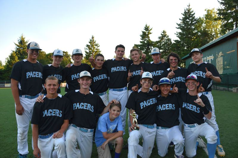 The Lakeridge baseball team poses with the trophy it earned at Jesuit High School last week. The Pacers topped the Crusaders 11-1 in the final.