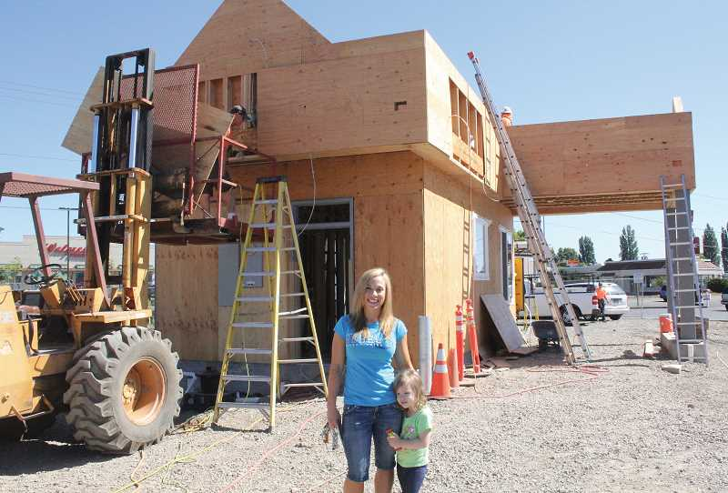 by: PHOTO BY JEFF MCDONALD - Shannon Williams, left, with her daughter Rylan, expects to open her second Dutch Bros. Coffee stand in late August.