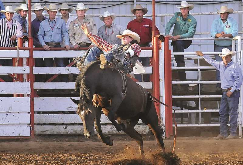 by: PHOTO BY GARY ALLEN - The Bareback Riding competition (above) provided the St. Paul Rodeos biggest payout this year. Cody DeMers of Kimberly, Idaho won the event for the second time in the past three years after scoring 86 points on Growney Bros. Rodeos Bittersweet to earn $10,465. DeMers was one of 10 champions named at this years rodeo.