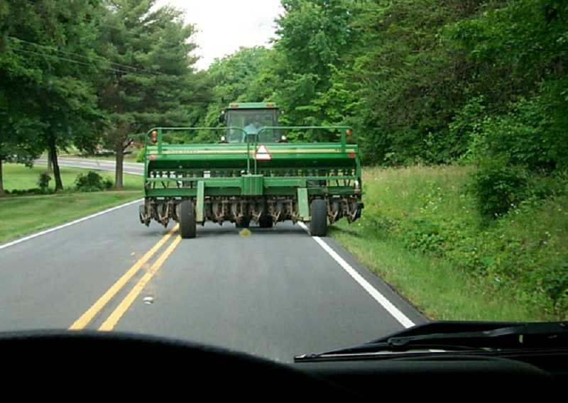 Give farm equipment time to find a place to pull over on narrow roads so you can pass.